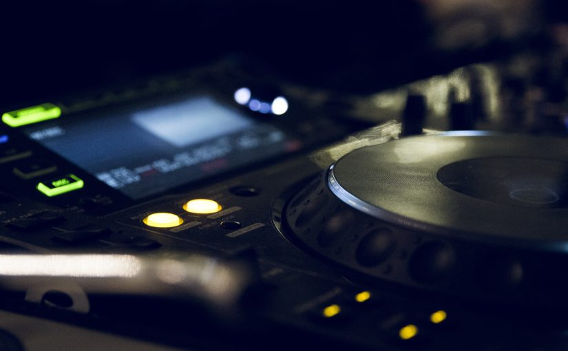 Digital DJ turntables playing a remix production